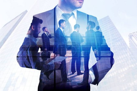 Photo for Conference and urban concept. Group of young businesspeople on abstract office city background. Double exposure - Royalty Free Image