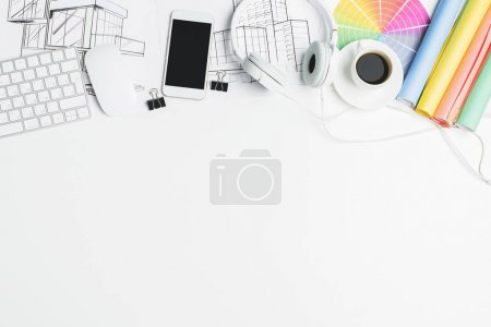 Photo for Top view of creative white office desk with empty electronic devices and supplies. Mock up - Royalty Free Image