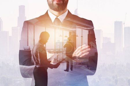 Photo for Businessman on abstract office interior background with sunlight and copy space. Success and future concept. Double exposure - Royalty Free Image