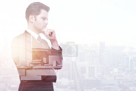 Photo for Thoughtful young businessman on abstract city background with copy space. Think and employment concept. Double exposure - Royalty Free Image