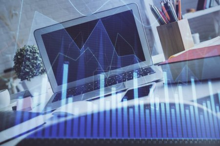 Photo for Forex market chart hologram and personal computer background. Multi exposure. Concept of investment. - Royalty Free Image