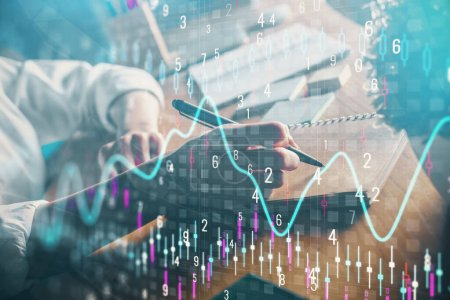 Photo for Financial forex charts displayed on womans hand taking notes background. Concept of research. Double exposure - Royalty Free Image
