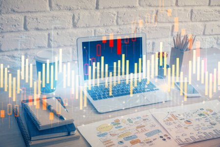 Photo for Financial chart drawing and table with computer on background. Double exposure. Concept of international markets. - Royalty Free Image