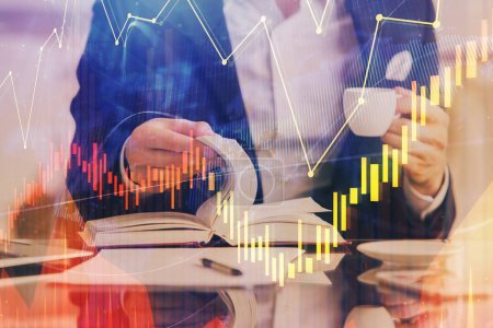 Photo for Double exposure of businessmans hands withcup of coffee with stock market graph background. Concept of research and trading. - Royalty Free Image