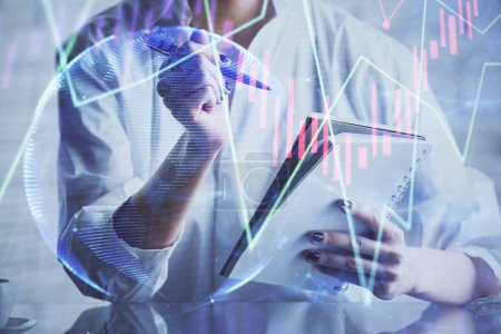 Photo for Financial chart drawn over hands taking notes background. Concept of research. Multi exposure - Royalty Free Image