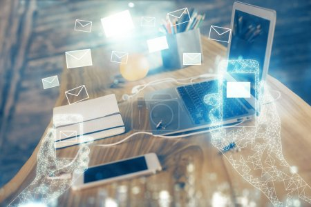 Photo for Desktop computer background in office and flying envelops hologram drawing. Multi exposure. Electronic mail concept. - Royalty Free Image