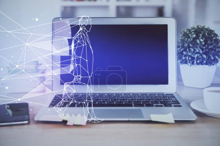 Photo for Desktop computer background in office and start up theme hologram drawing. Double exposure. Startup concept. - Royalty Free Image