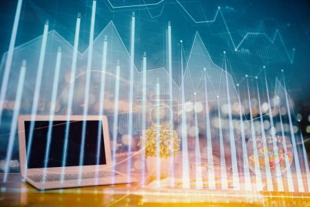 Photo for Forex graph hologram on table with computer background. Double exposure. Concept of financial markets. - Royalty Free Image
