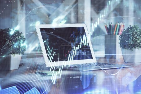 Photo for Financial market graph hologram and personal computer on background. Multi exposure. Concept of forex. - Royalty Free Image