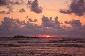 Beautiful setting sun over the ocean on the Hikkaduwa turtle bea