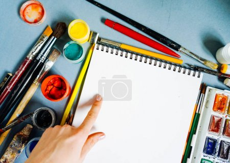 Photo for White sheet of paper on a background of multi-colored paints - Royalty Free Image
