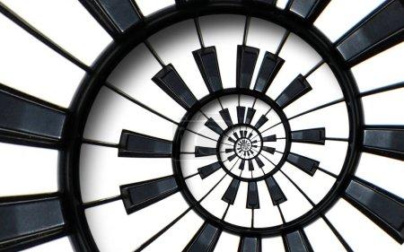 Klaviertastatur gedruckt Musik abstrakten fraktalen Spiralmuster Hintergrund. schwarze und weiße Klavierspirale. Spirale Piano helical pattern abstrakter Hintergrund abstrakte Piano Spirale Effekt. Treppe