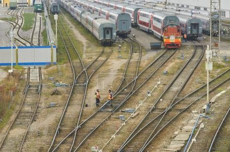 MOSCOW, RUSSIA, OCT,26, 2017: Russian Railways passenger trains in Rizhskaya depot under maintenance. RZD passenger coaches. Rail way workers maintain tracks and infrastructure. Rail road maintenance