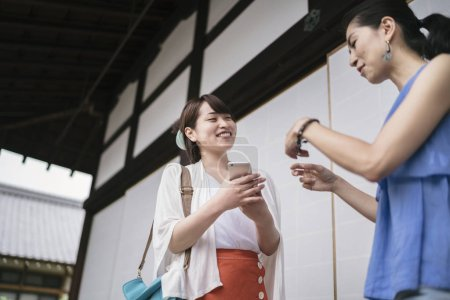 two young japanese women talking