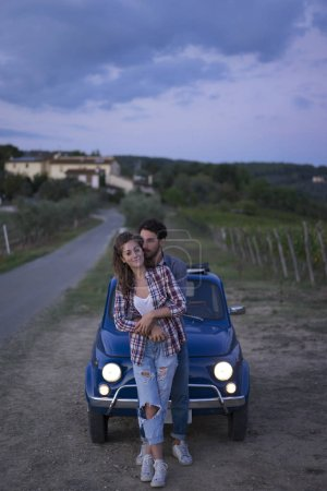 Young couple trip with vintage car