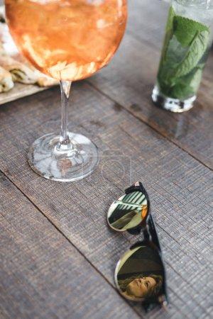 sunglasses on a restaurant table