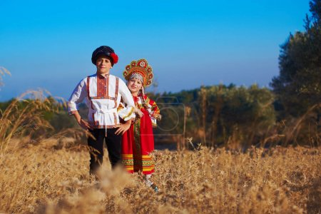 Photo for Girl and boy together  in Russian folk costume - Royalty Free Image