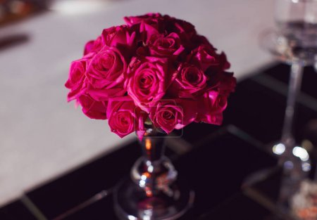 Beautiful delicate wedding decoration with roses and eustoma