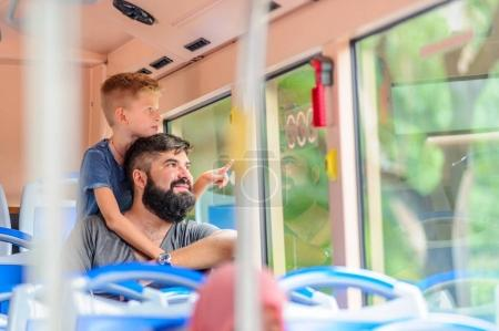 Photo for Father and son happy and excited together for the trip to Kuala Lumpur. Making a city tour. Holiday vacation, traveling abroad concept, copy space - Royalty Free Image