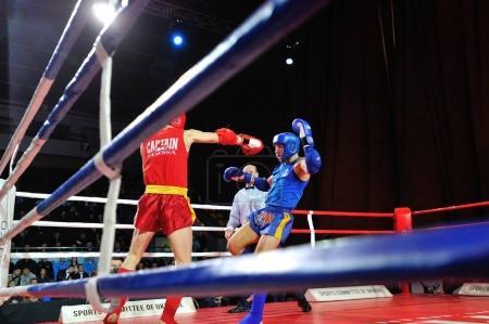 Photo for KIEV, UKRAINE - DECEMBER, 16, 2015: Ukrainian Combat Games III - nationwide Combat Games - fight of Ukrainian Muay Thai-athletes for the Champion title - Royalty Free Image