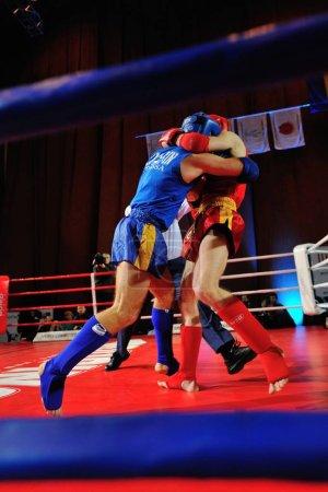 KIEV, UKRAINE - DECEMBER, 16, 2015: Ukrainian Combat Games III - nationwide Combat Games - fight of Ukrainian Muay Thai-athletes for the Champion title