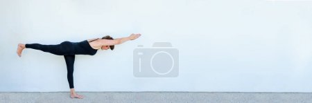 Photo for Yoga students showing different yoga poses. - Royalty Free Image