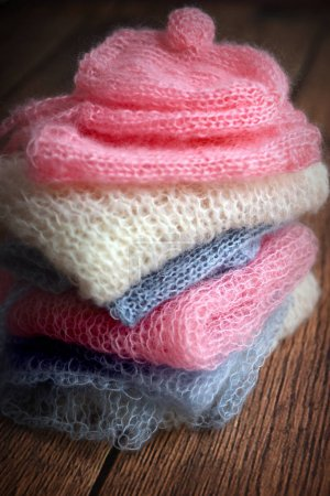 Pile of soft mohair hand knit clothes