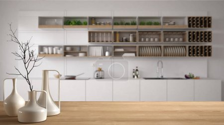 Wooden table top or shelf with minimalistic modern vases over blurred scandinavian modern kitchen, white interior design