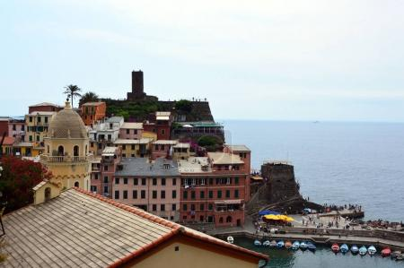 View of Vernazza tower church and houses with the harbour, Cinque Terre national park, Liguria, Italy