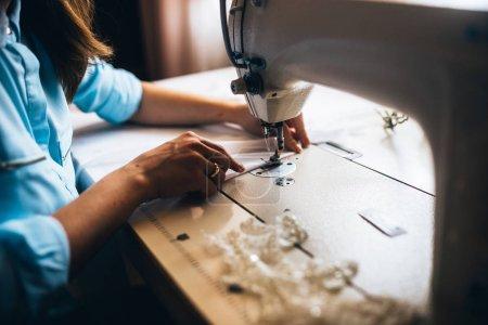 Girl sewing wedding dress