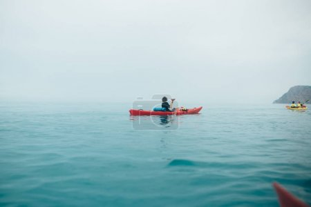 in the sea on a kayak