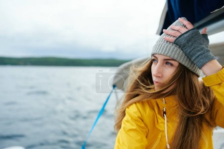 woman on yacht at cold day