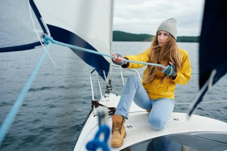 woman on yacht at stormy day