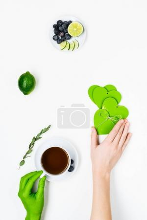 coffee with limes and hands