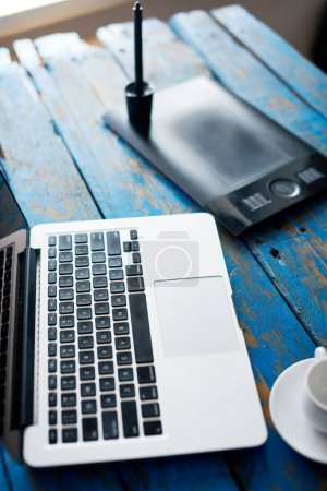Graphic designer's working equipment on the table