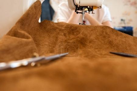Threading leather on sewing machine