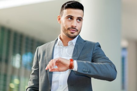 Businessman watching wrist watch