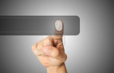 Man using his fingerprint on a screen