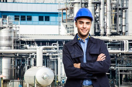 Worker in front of factory