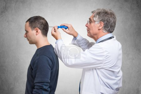 Psychiatrist using a screwdriver to fix patient mind