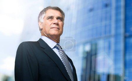 senior businessman in city
