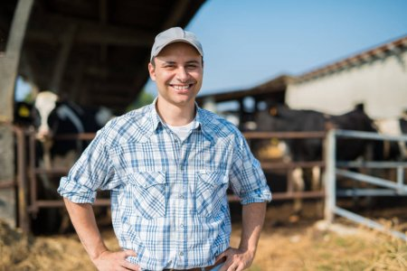 farmer in front of his cows