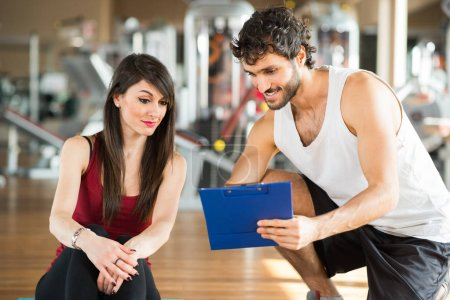 Woman talking to personal trainer