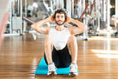 Man working out abdomen in gym