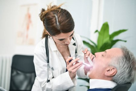 Doctor looking in patients mouth