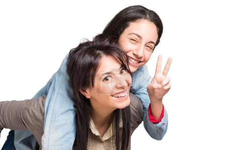 Mother and daughter showing victory sign