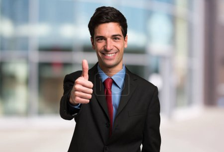 Photo for Confident businessman giving thumbs up, business success concept - Royalty Free Image