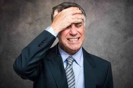 Photo for Portrait of a worried and stressed businessman - Royalty Free Image