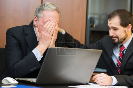 Photo for Businessman comforting his depressed and sad boss - Royalty Free Image