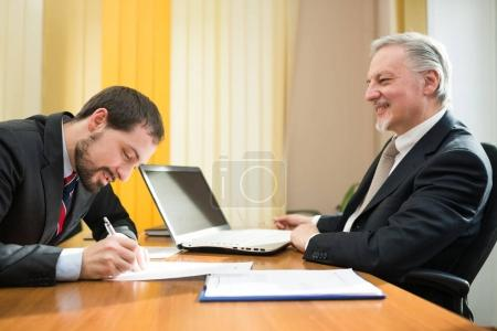 Businessman signing a deal